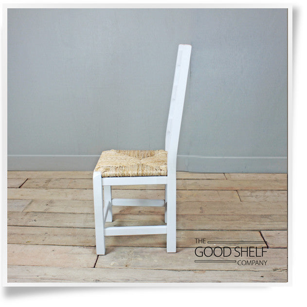 Painted wooden ladder back dining chair with woven natural rush seat