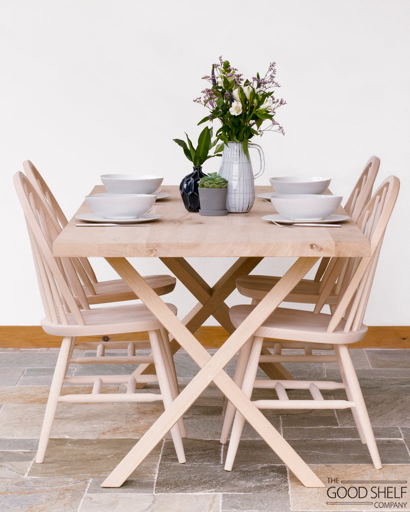Oblique X frame Dining Table made from Solid Rustic Grade Oak with  legs that cross in an X shape
