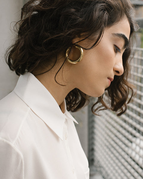 Laura Lombardi Round hoop earrings at Rena Sala store photographed by Iringo Demeter