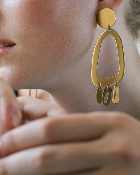 Modern Weaving Odd Oval brass earrings for Rena Sala store photographed by Iringo Demeter