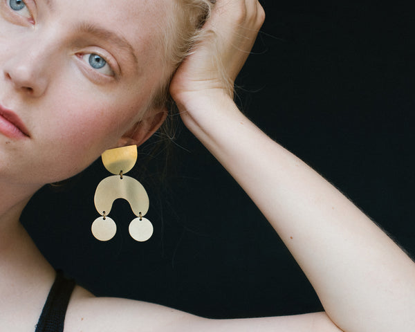 Modern Weaving Moon Dancer brass earrings for Rena Sala store photographed by Iringo Demeter