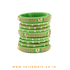 Charming Parrot Green Colour Silk Thread Grand Bangle Set With Stones