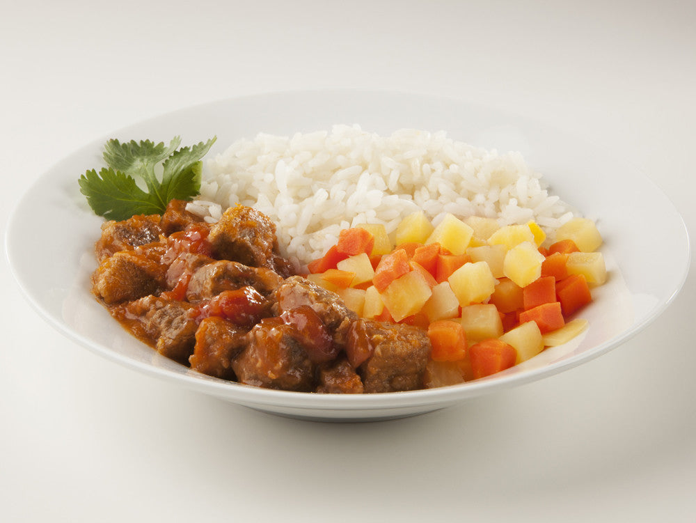 Spicy beef stew with rice, carrots and turnips