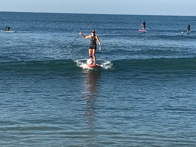Kristin Thomas SUP surf in her Truli Wetsuits