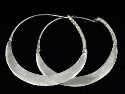 Handbeaten silver hoop tribal earrings from Afghanistan featuring wrapped silver ends