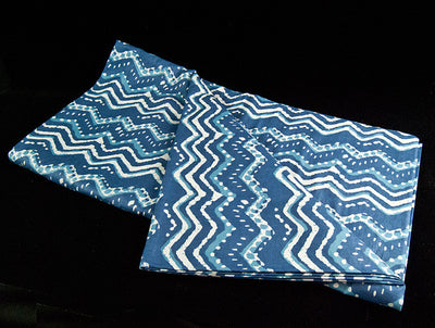 Block printed organic cotton tablecloth featuring natural indigo dye and a bold white and blue geometric pattern
