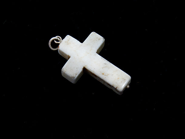 Howlite stone cross pendant, with sterling silver mount and ring bail, and a tiny silver ball detailing at the base of the cross. Thick cut and chunky in design, this would look great on a silver chain or a leather cord. Suitable as men's jewellery or women's jewellery.