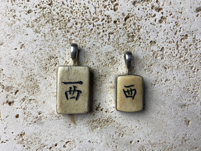 Vintage bone mahjong pieces set in sterling silver to create wonderful pendants. Unisex jewellery suitable for men or women