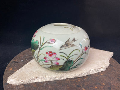 Round, flower motif Chinese ceramic tea canister, featuring a delightful transfer-painted motif of flowers and birds.