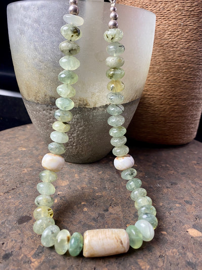 Natural prehnite bead necklace featuring large rondel beads, vintage Naga shell beads and a sterling silver hook clasp. A unique piece that's designed to be worn as a choker
