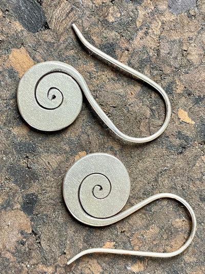 Silver flat spiral earrings with a slight matte finish