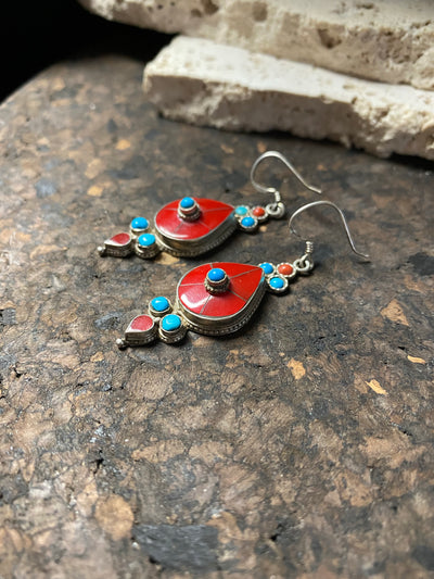 Classic Tibetan earrings, consisting of panels of turquoise and coral set in sterling silver