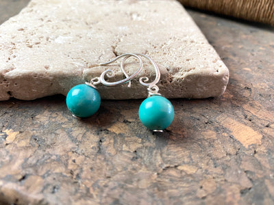 Simple and elegant turquoise ball earring drops finished with sterling silver hooks