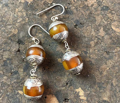 Vintage silver capped amber earrings finished with sterling silver in beautiful Boho style.