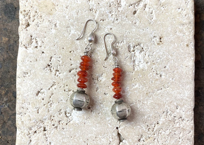 Carnelian rondel beads team up with vintage silver Indian beads to give a beautiful drop earring with a tribal boho style
