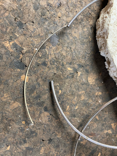 The largest silver hoop earrings possible, measuring 12 cm (4.75 in) inside diameter. Sterling silver with a simple inline fastening