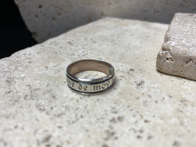 "Ring with meaning - silver band says ""think of me"" in old French"