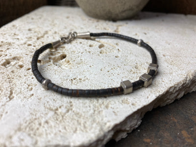 fine cut coconut wood beads and Karen hilltribe 95% pure silver. These tribal bracelets are made especially for people who don't normally wear much jewellery, or like to stack their bracelets
