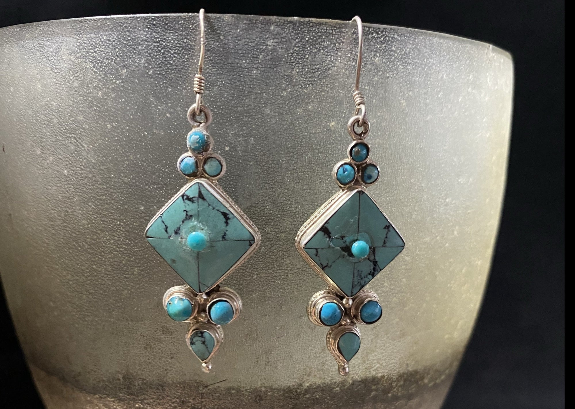 Classic Tibetan earrings, consisting of panels of turquoise set in silver