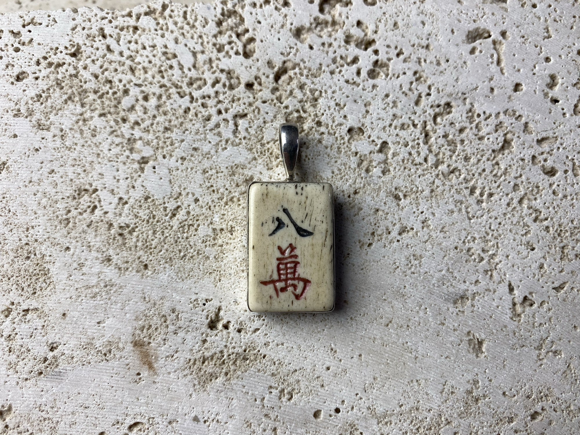 vintage bone mahjong piece set in sterling silver.. Unisex jewellery suitable for men or women.  This is the symbol for 8 multiplied up to 80,000