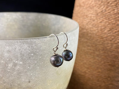 Cultured round black pearl earrings featuring high quality black Burmese pearls 7 mm in diameter and sterling silver hooks
