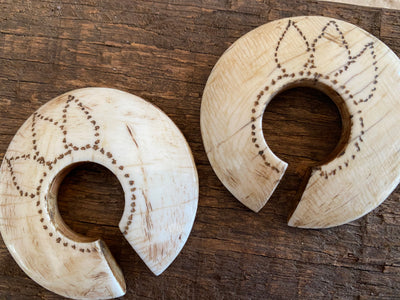 Shell ear ornaments as worn by Naga women. These earrings are cut from the shells of the giant gastropod Turbinella sp that lives in the Bay of Bengal. Shell ornaments, worn so far from the sea, are a sign of wealth and tribal ranking.  Vintage, with signs of wear equal to their age.  These beautiful earrings would also make lovely pendants.  Measurements: diameter approximately 5.6 cm