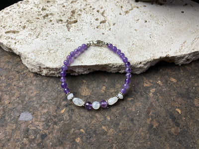 fine beaded bracelet of amethyst and rainbow moonstone, finished with sterling silver detailing and clasp