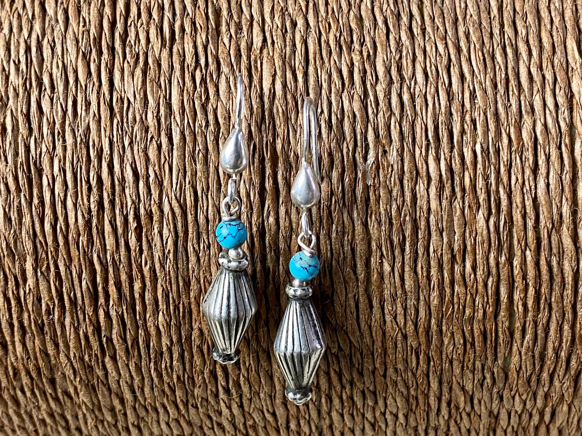 Vintage silver bead from India is teamed up with genuine American turquoise to create a beautiful boho drop earring