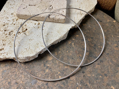 The largest silver hoop earrings possible, measuring 12 cm (4.75 in) inside diameter. Sterling silver