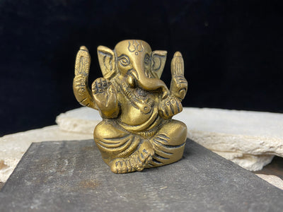 Small brass seated ganesh statue