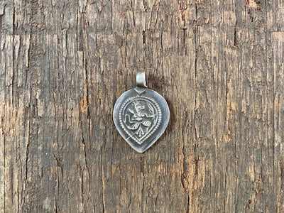 Antique silver amulets representing the Hindu god Hanuman, traditionally worn for protection and good luck. Originating in southern India, and dating from the early 19th - early 20th century.  All vary between 1.4 and 1.7 cm in width