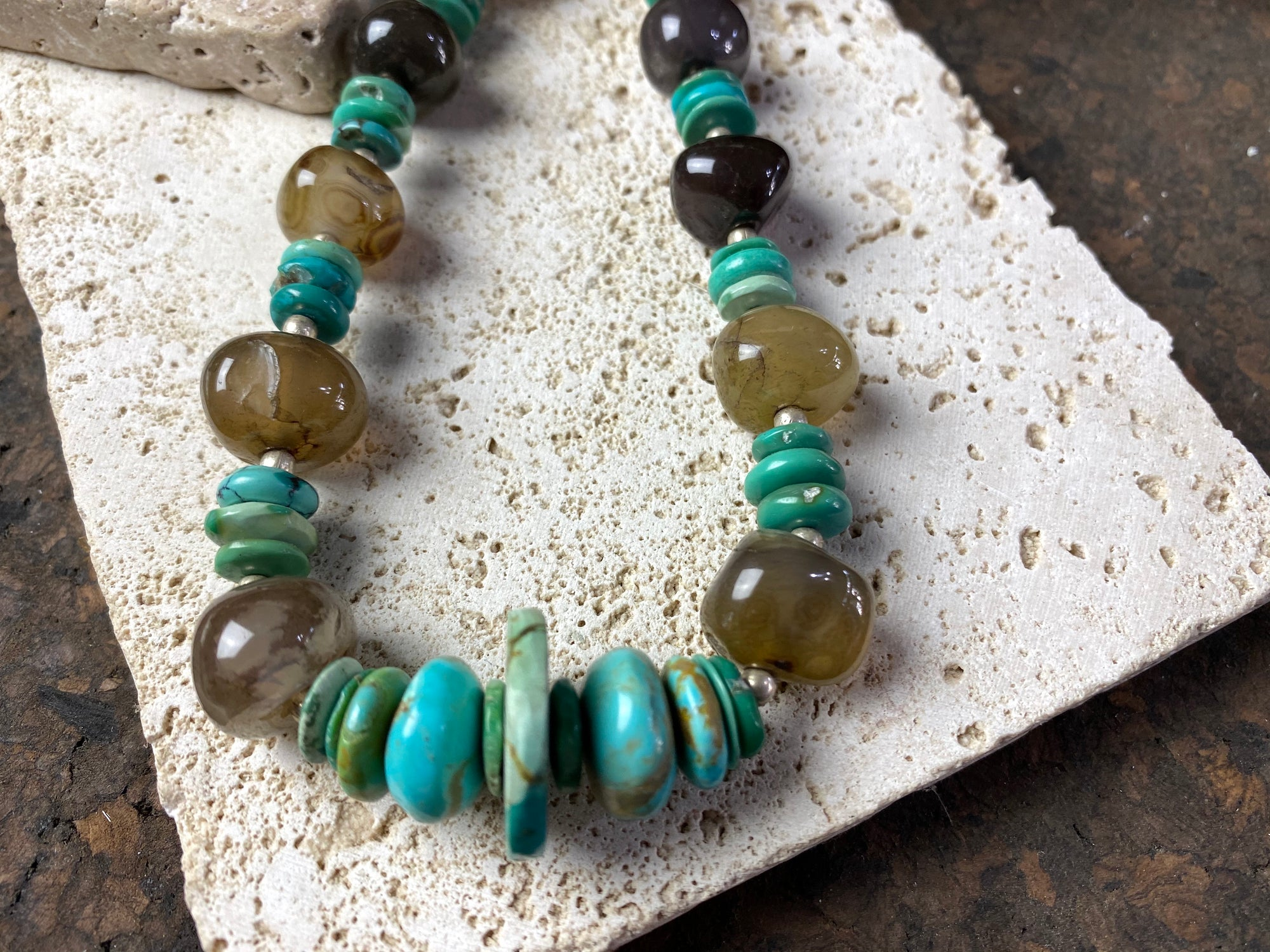 organic necklace made from polished boulder agate stones, natural blue Arizona turquoise discs and sterling silver beads, with a sterling silver hook clasp