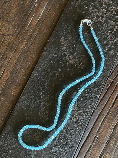 Light blue facet cut apatite bead necklace with sterling silver lobster clasp. The apatite is natural, not dyed or heat treated.