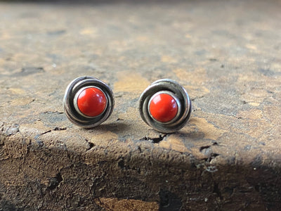 Red coral and sterling silver ear studs with a twisted silver bezel design. Simple and beautiful, 9 mm diameter