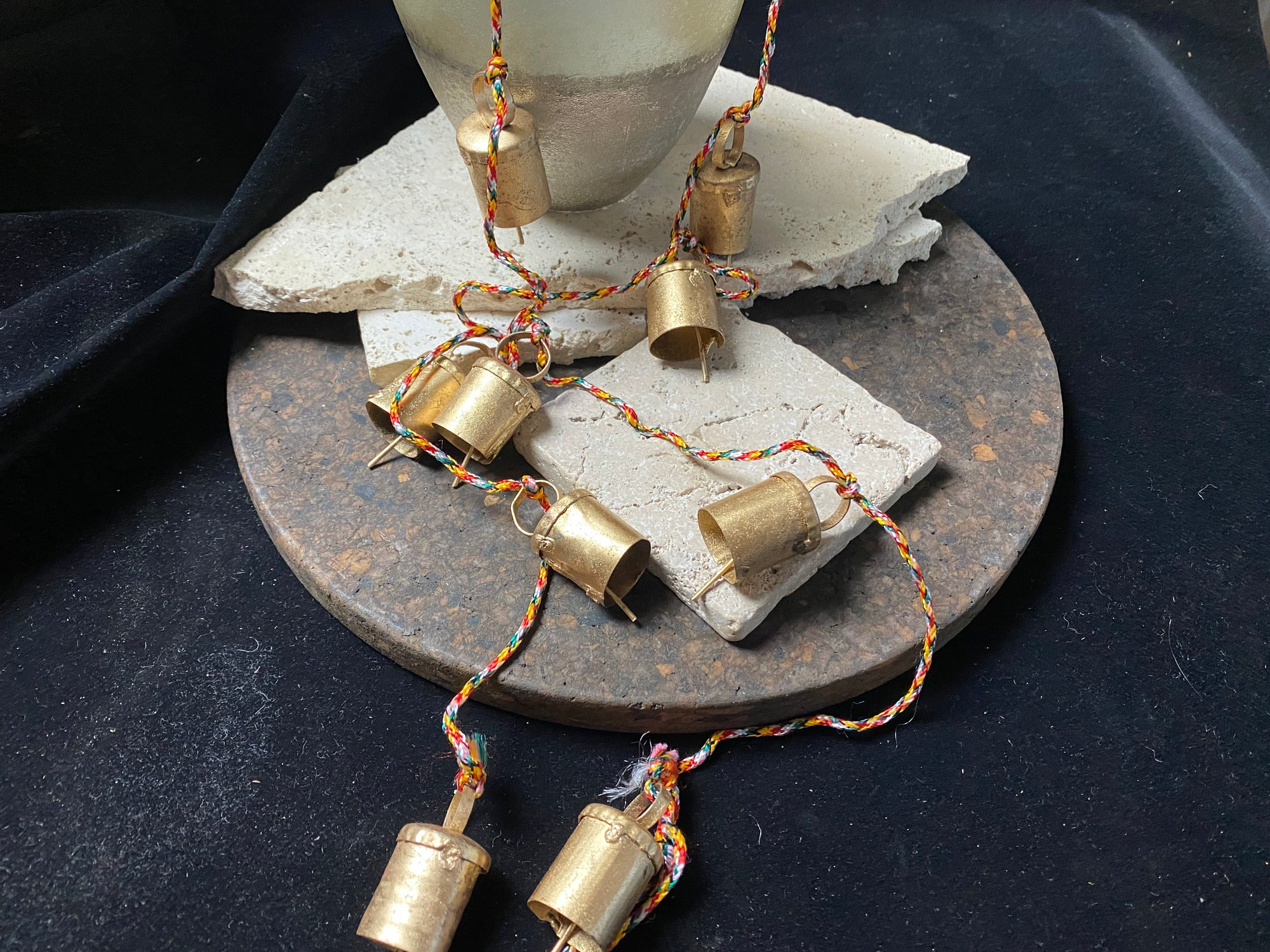 Bells on strings, from Nepal. Perfect for use as door bells or as wind chimes