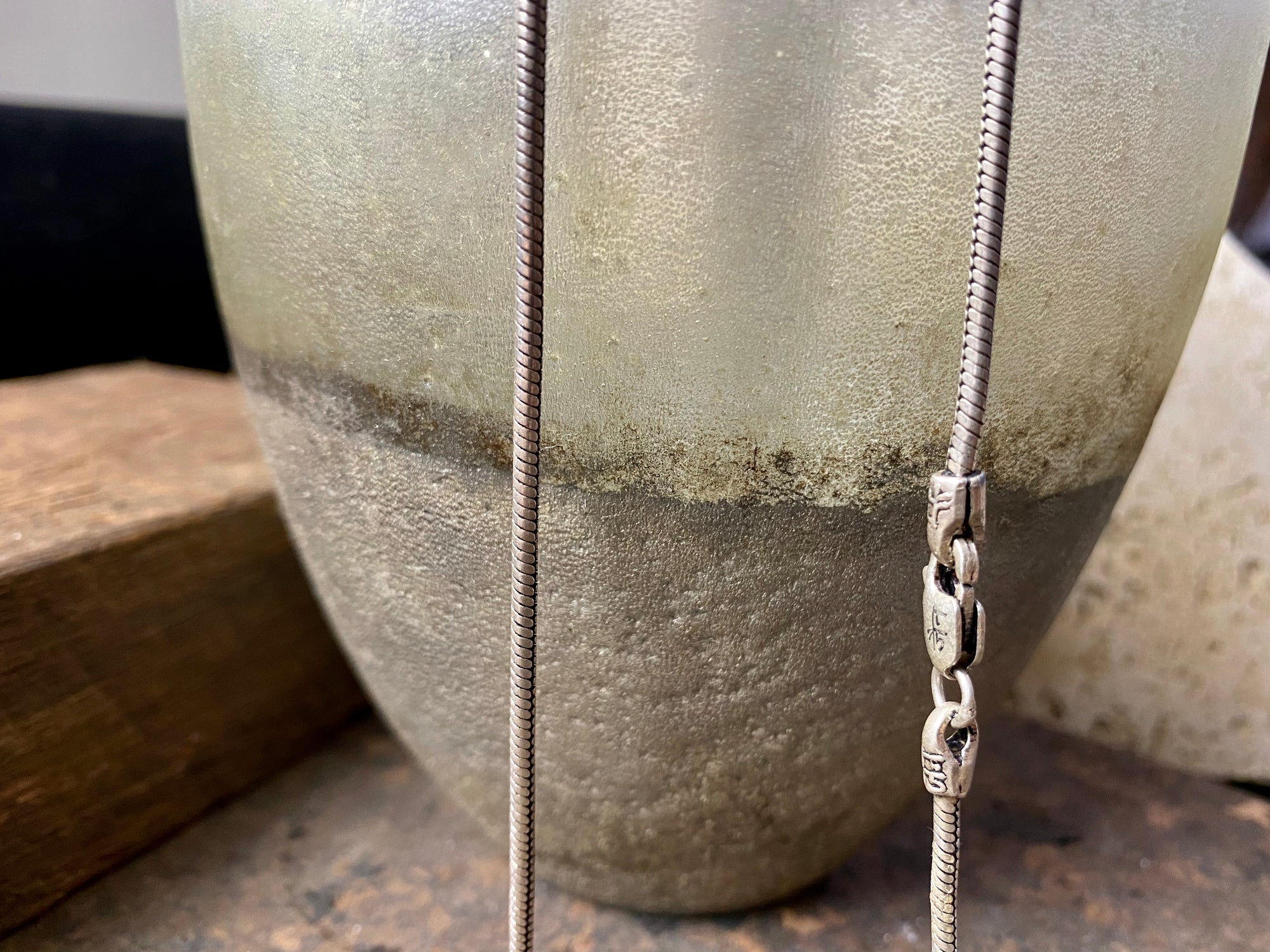 Open weave style silver snake chain, sterling silver, with a lobster claw clasp. Slightly oxidised to show the weave texture.