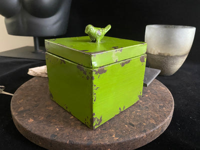 Chinese trinket box with bird on top is painted green with a distressed finish