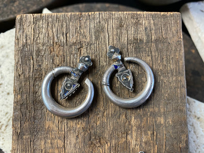 Large pair of tribal silver earrings called Bent Arrow. Worn pushed sideways through the ear by Yao women. High grade silver, they can only be worn with an extended piercing