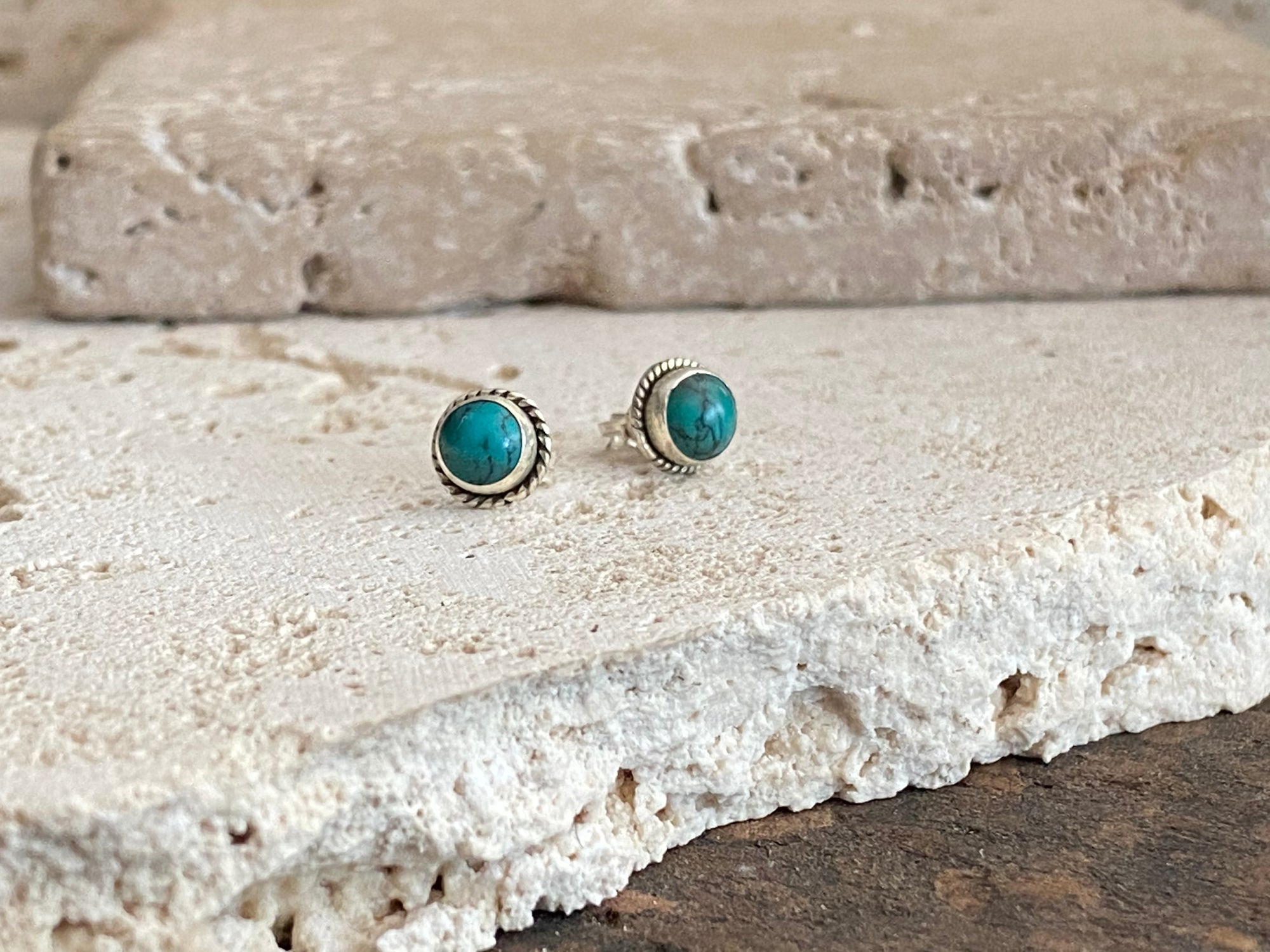 Turquoise stud earring with a twisted wire bezel. Sterling silver post and butterfly back