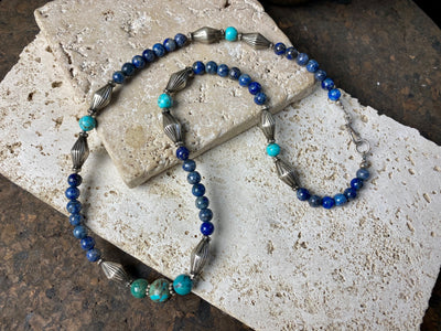 mid blue lapis lazuli and natural turquoise Boho style necklace is set off with vintage indian silver beads and sterling silver detailing