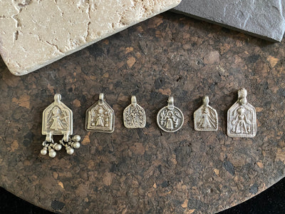 Antique silver amulets represent the Hindu goddess Kansari, goddess of the harvest and of fertility. These small pendants are traditionally worn for good luck, to increase fertility and to bring all good things to you and your home. These pendants date from the early 19th - early 20th century.  Measurements: all vary between 1.4 and 1.8 cm in width