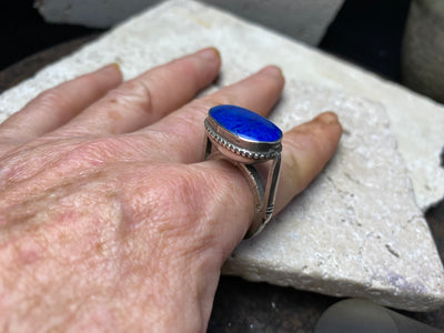 impressive and unusual tribal silver ring features a large lapis lazuli stone