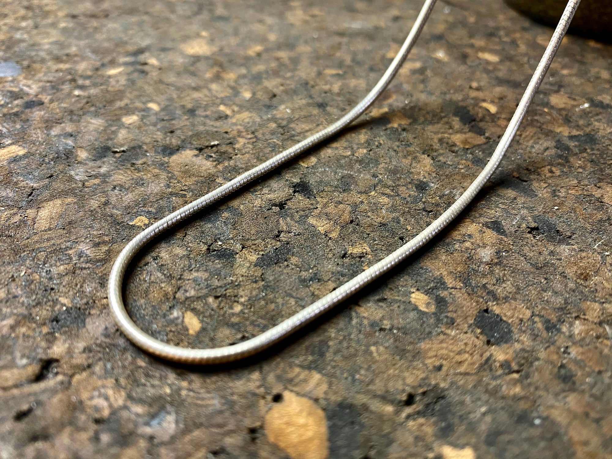 fine sterling silver snake chain is densely woven and strong, with a bright silver finish and ring clasp