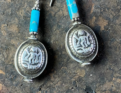 Unique statement earrings featuring genuine turquoise and vintage silver beads from india featuring an image of Lakshmi, goddess of wealth and prosperity