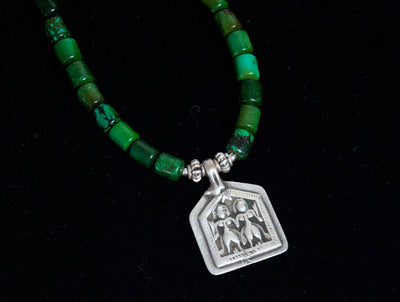 turquoise and antique silver amulet necklace