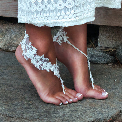 2713088565f4 Bare Feet Bride Wearing Ivory Barefoot Sandals on Stones. Sister Lace