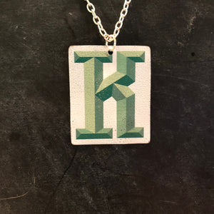 Green K Tin Necklace
