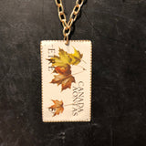 Eire Canada Aontas Stamp Tin Necklace
