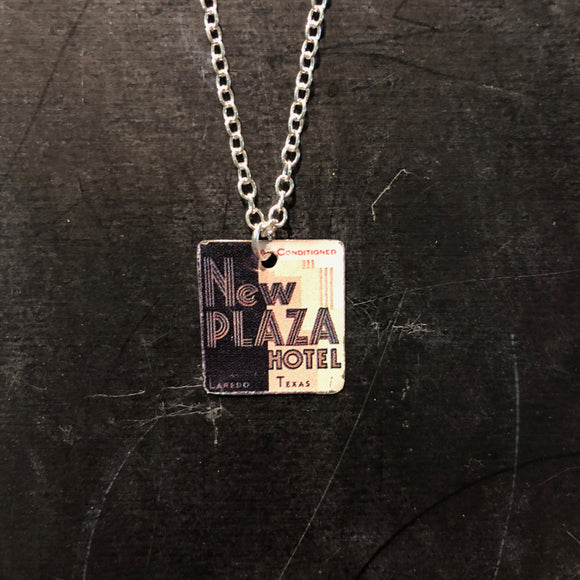 New Plaza Hotel Tin Necklace