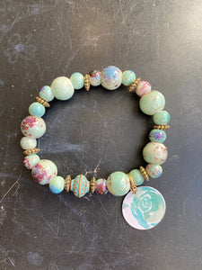 Turquoise Variegated Ceramic Bead with Vintage Copper Toned Tin Charm Bracelet